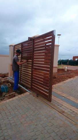 Driveway gate clad in balau