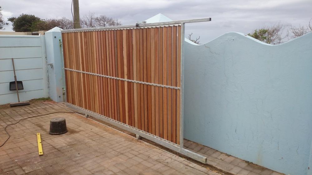 Driveway gate clad in balau wood (3/3)