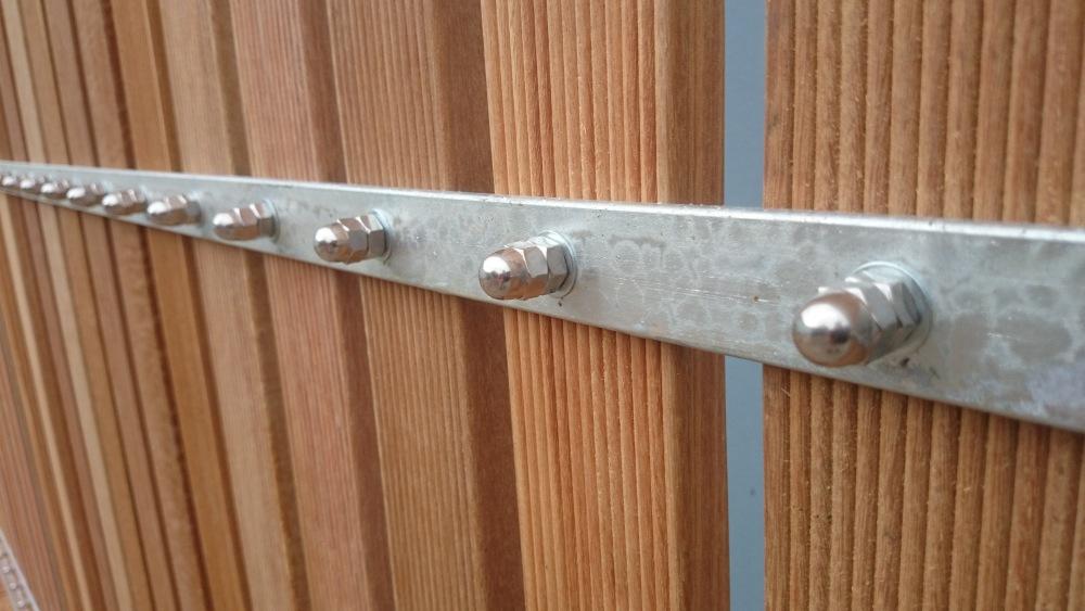 Driveway gate clad in balau wood (2/3)